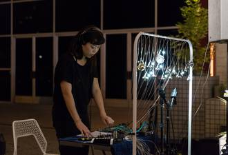 Performing amplified bell controller at MOCA, October 2017. Photo by Ian Byers-Gamber.